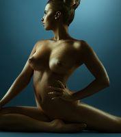 Golden skin woman artistic studio nude portrait