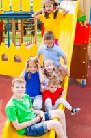 Kids traffic jam on slide in the summer outdoors
