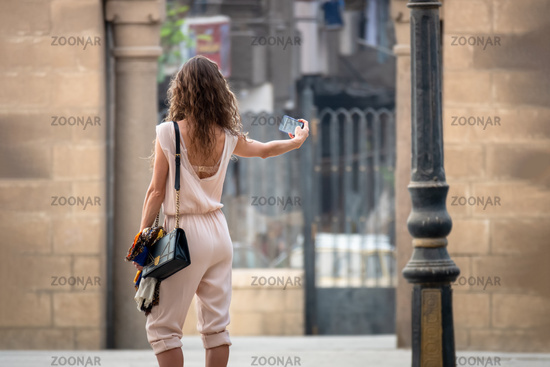 A girl takes a selfie in Cairo