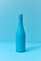 Holiday champagne mock up bottle painted blue with soft shadows.