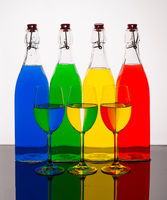 Bottles Of Exotic Healthy Juice Color Mix On White Background