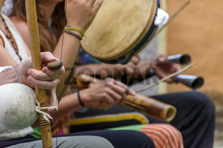 Berimbau and others instruments players during presentation of Brazilian capoeira