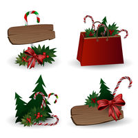 Set of festive composition with Christmas tree branches in a gift bag and boxes with bows on a white background.