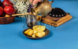 A female hand takes a with honey for the apple slice and pomegranate holiday of Rosh Ha Shana