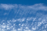 Streaky and puffy Cirrocumulus Clouds against blue sky. Landscape orientation.