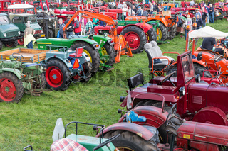 Visitors at an exposition of tractors during a Dutch agricultural festival