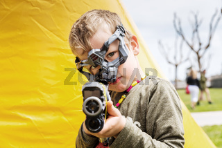 Valencia, Spain - April 29, 2019: Children playing with laser guns at an outdoor camp.
