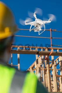 Female Pilot Flies Drone Quadcopter Inspecting Construction Site