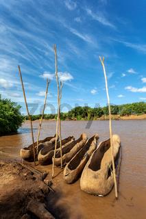 wooden coarse boat on mystical Omo river, Ethiopia