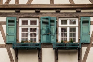 Sindelfingen, Baden Wurttemberg/Germany - May 11, 2019: Two colorful wooden windows on a traditional half-timbered house facades.