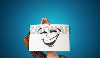 Person holding a paper with cool emoticon face