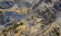 Aerial view of dunes of sand and clay in an abandoned quarry. Hills, canyons and sand dunes.