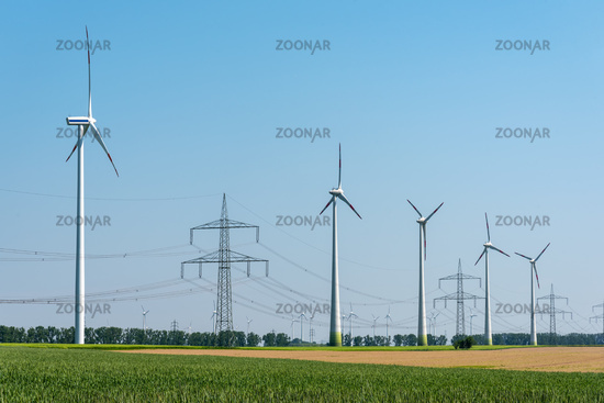 Overhead power lines and wind turbines in the fields in Germany