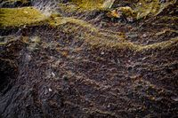 Stones texture and background. Rock texture. Dark grey black slate texture