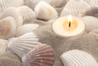 Wellness and spa - sea shells and candle in the sand