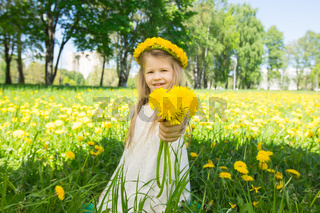 Girl with floral head wreath and bunch