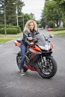Young woman on sport motocycle