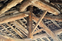 Wooden beam in a roof construction