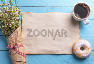 Blank vintage paper with flowers and breakfast on a blue table