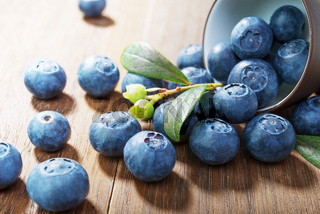 Blueberries  on rustic  wooden background