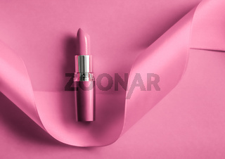 Luxury lipstick and silk ribbon on pink holiday background, make-up and cosmetics flatlay for beauty brand product design