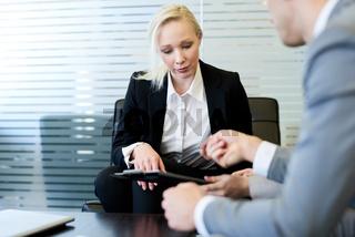 Female Boss Reviewing Report