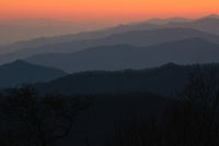 Blue Ridge Mountains have a blue color at dusk on a fall evening.