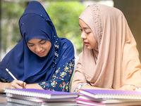 Muslim Student reading book
