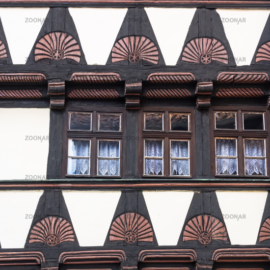 Close-up of timbered houses with fanlike frieze