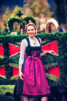 Woman in the Dirndl in front of a float