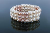 bracelet of pearls with reflection on a gray background