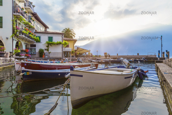 Fischerman boats at port of limone at lake Garda, Brescia, Lombardy, Italy