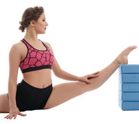 Woman exercising with bricks for stretching