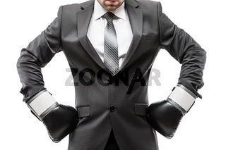 Businessman boxer in black suit wearing sport boxing gloves