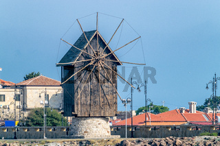 The wooden windmill on the isthmus Nessebar ancient city, one of the major seaside resorts on the Bulgarian Black Sea Coast. Nesebar or Nesebr is a UNESCO World Heritage Site. The windmill in Nessebar