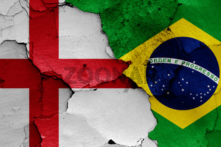 flags of England and Brazil painted on cracked wall