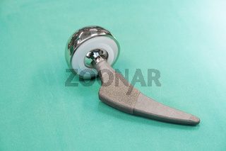 hip prosthesis on green surgical drape