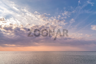 A beautiful sunset with magenta clouds and beautiful colors at sea. Beautiful sunrise clouds at sea