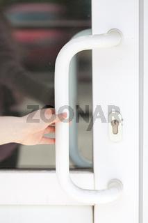 the girl opens the glass door