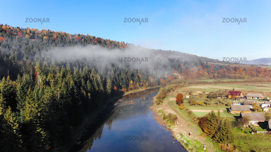 Over the mountain river Stryi. Beautiful autumn nature in Carpathians, Ukraine
