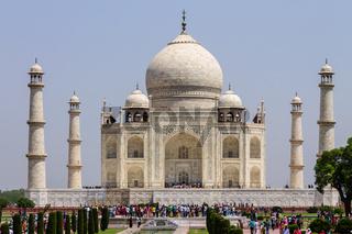 Taj Mahal with walkway, garden square, reflecting pool and visitors. UNESCO World Heritage in Agra, Uttar Pradesh, India