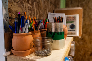 Color pencils and books in a workshop