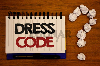 Text sign showing Dress Code. Conceptual photos Rules of what you can wear and not to school or an eventIdeas on notebook wooden background quotation mark made of crumpled papers.