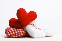 Textile hearts on white