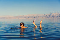Girl is relaxing and swimming in the water