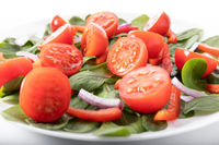 Fresh salad with tomatoes, isolated on white background