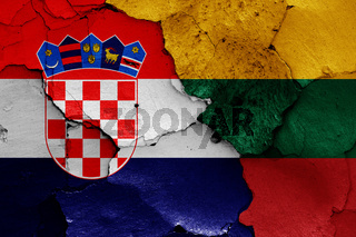 flags of Croatia and Lithuania painted on cracked wall