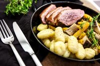 Roasted duck with pear,marinated in red wine with gnocchi and Oysters