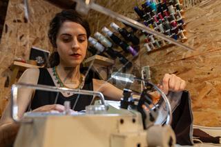 Fashion designer using vintage overlock