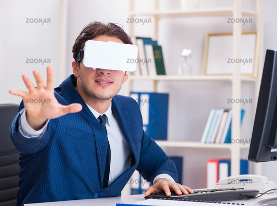 Employee using virtual reality glasses in office
